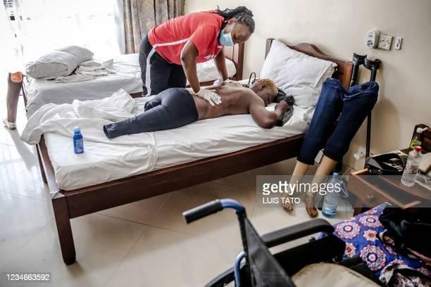 Kenyan para-rower athlete Asiya Mohammed receives a massage and physiotherapy session from Team Kenyas physiotherapist Josephine Kaburu before...