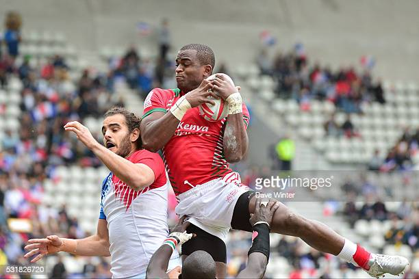 A Kenyan player out jumps Jonathan Laugel of France at the linnet during the HSBC PARIS SEVENS tournament at Stade Jean Bouin on May 15 2016 in Paris...