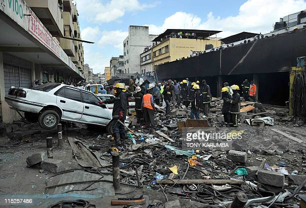 Kenyan police fire crews and emergency workers clear debris from the scene of an explosion in the Kenyan capital Nairobi on June 5 2011 At least 28...