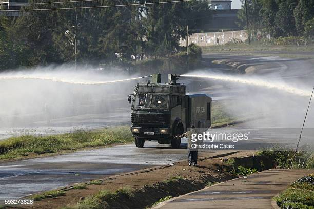 Kenyan police fire water canons at supporter of Raila Odinga preventing their entrance into Uhuru Park in central Nairobi for their party's political...