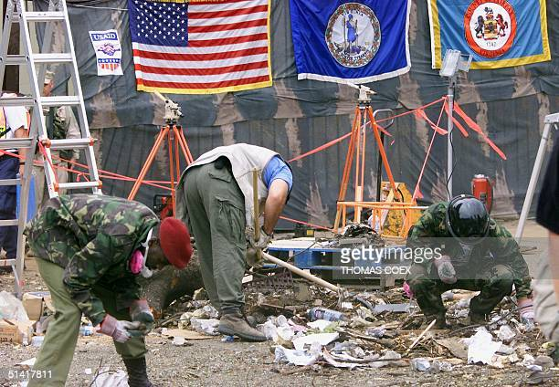 Kenyan police officers and FBI agent search for evidences 11 August in Nairobi after the 07 August bombing of US embassy in Kenya The death toll in...