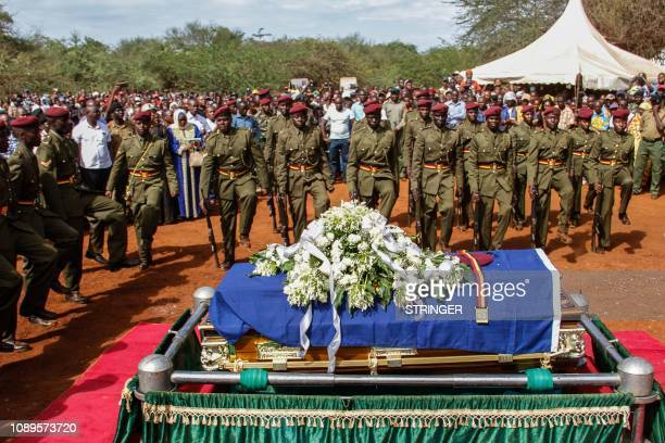 Kenyan police officers of General Service Unit pay a tribute as they attend the burial ceremony of Japhet Nuru, the GSU officer who was killed in...