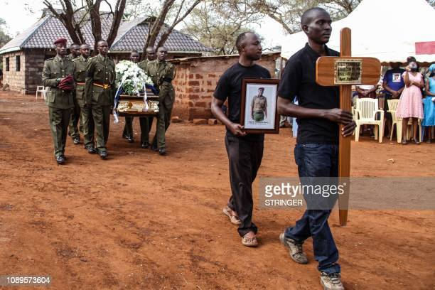 Kenyan police officers of the General Service Unit carry the coffin of Japhet Nuru the GSU officer who was killed in last week terror attack in...