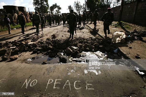 Kenyan police search supporters of Kenya's opposition leader Raila Odinga during clashes in the Kibera slums January 17 2008 in Nairobi Kenya...