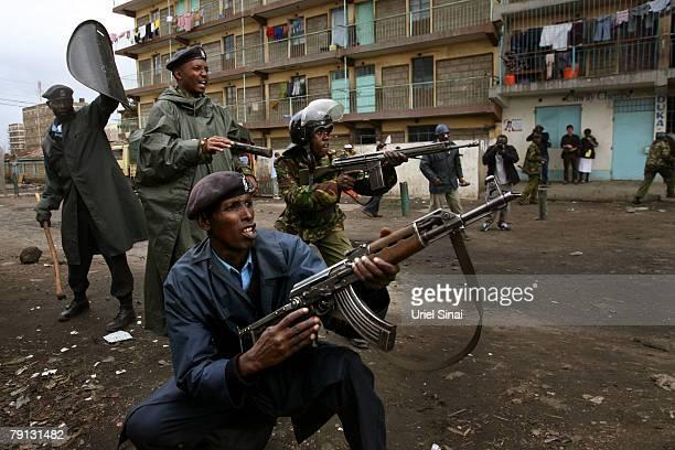 Kenyan policemen holding rifles confront demonstrators during clashes in the Mathare slums on January 20 2008 in Nairobi Kenya International...