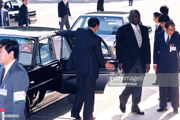 Kenyan President Daniel Arap Moi is seen on arrival at the Imperial Palace to attend the 'SokuinoRei' Emperor's Enthronement Ceremony at the Imperial...