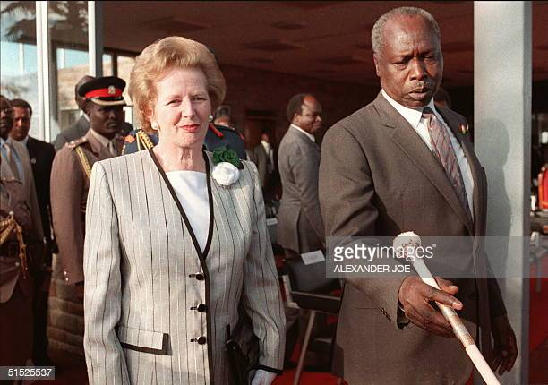 Kenyan President Daniel Arap Moi shown in a picture dated 4 January 1988 in Nairobi as he shows the way to the British Prime Minister Margaret...