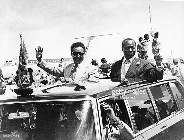 Kenyan President Daniel arap Moi waving tom the open top of his car in Nairobi Kenya 1979