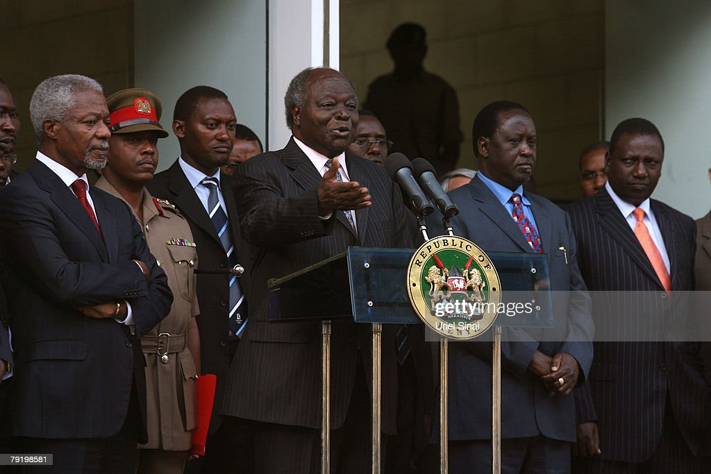 Kenyan President Mwai Kibaki,(C) talks to the press during a joint press conference with Kenya's opposition leader Raila Odinga and former U.N. Secretary-General Kofi Annan (L) outside the president's office on January 24, 2008 in Nairobi, Kenya. The meeting between the two rivals is the first since the disputed presidential election that led to bloodshed across the country.