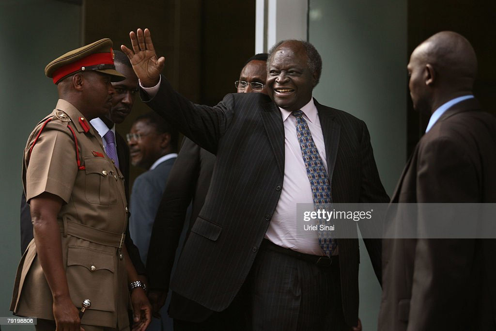Kenyan President Mwai Kibaki waves as he arrives at a joint press conference with Kenya's opposition leader Raila Odinga and former U.N. Secretary-General Kofi Annan outside the president's office on January 24, 2008 in Nairobi, Kenya. The meeting between the two rivals is the first since the disputed presidential election that led to bloodshed across the country.