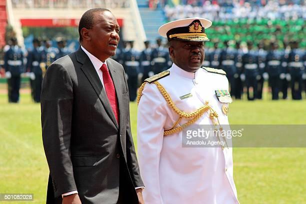 Kenyan President Uhuru Kenyatta and Kenya's Chief of the General Staff Samson Mwathethe attend the celebrations of Jamhuri Day at Nyayo National...