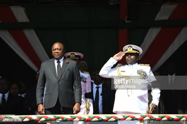 Kenyan President Uhuru Kenyatta flanked by General Mwathethe the Chief of Defence Forces salutes as the coffin of late former Kenya President Daniel...
