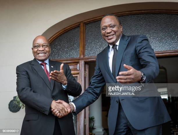 Kenyan President Uhuru Kenyatta is welcomed by South African President Jacob Zuma at the Dr John Dube House in Durban on January 11 during a state...