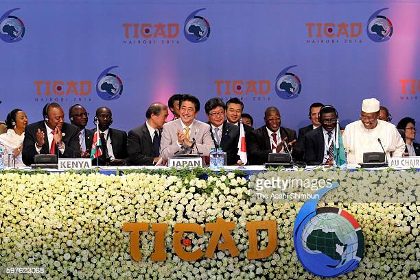 Kenyan President Uhuru Kenyatta Japanese Prime Minister Shinzo Abe and Chad President Idriss Deby applaud after the Nairobi Declaration during the...