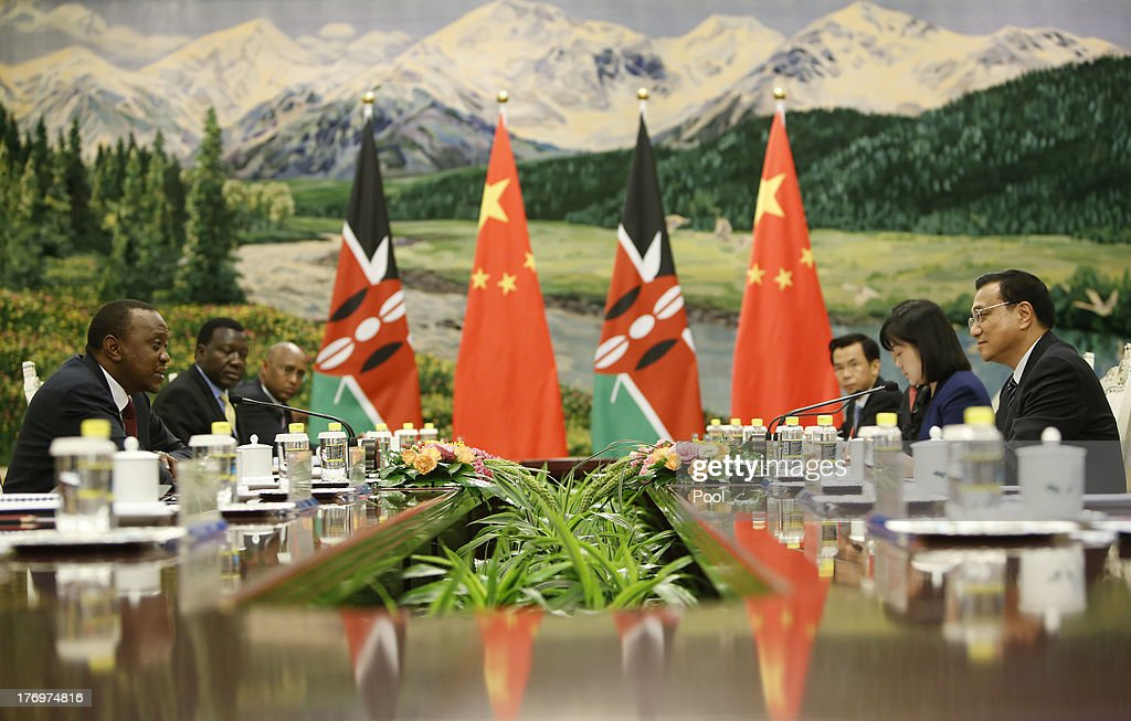 Kenyan President Uhuru Kenyatta (L) meets with Chinese Premier Li Keqiang (R ) at the Great Hall of the People August 20, 2013 in Beijing, China. An agreement was signed between the two countries that will allow mutual visa exemptions for holders of diplomatic service passports.