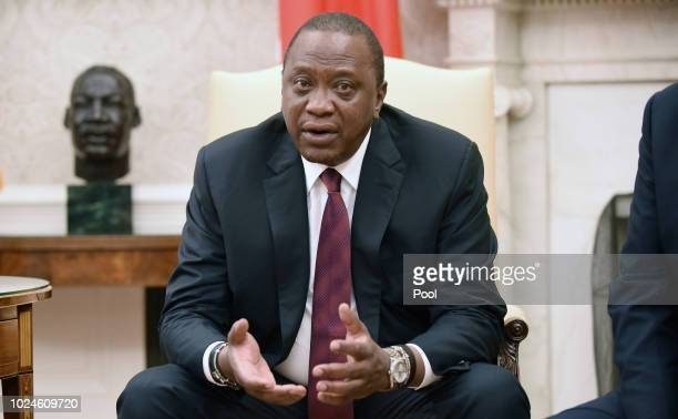 Kenyan President Uhuru Kenyatta speaks duirng a bilateral meeting with US President Donald Trump in the Oval Office of the White House August 27 2018...