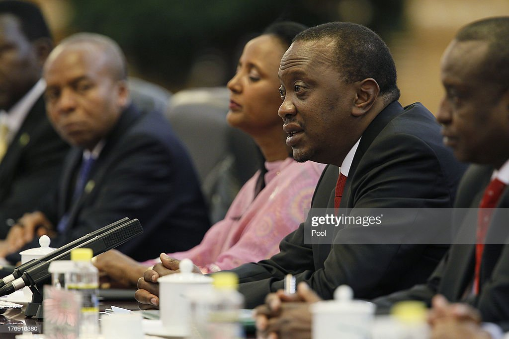 Kenyan President Uhuru Kenyatta (2nd R) speaks during a meeting with Chinese President Xi Jinping in the Great Hall of the People August 19, 2013 in Beijing, China. An agreement was signed between the two countries will allow mutual visa exemptions for holders of diplomatic service passports.