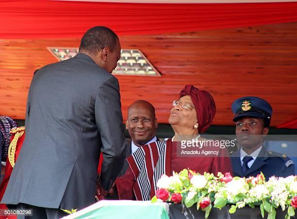 Kenyan President Uhuru Kenyatta welcomes Liberian President Ellen JohnsonSirleaf during the celebrations of Jamhuri Day at Nyayo National Stadium in...