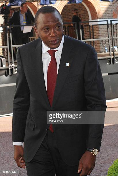 Kenyan President Uhuru Kenyattato arrives at the Somali conference in London with Somalian President Hassan Sheikh Mohamud on May 7 2013 in London...