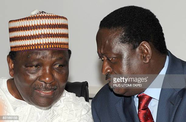 Kenyan Prime Minister Raila Odinga chats with former Nigeria's military Head of State General Yakubu Gowon during the 25th Silver Jubilee of the...