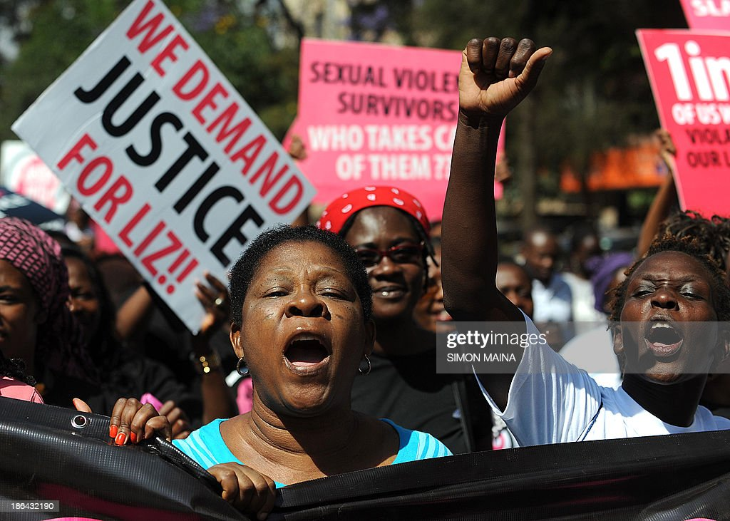 Kenyan protestors march towards the police headquarters on October 31, 2013 in Nairobi to deliver a petition of over a million names demanding justice after men accused of brutally gang raping a schoolgirl cut grass as punishment. The ferocious attack on the teenage girl and lack of action against those who carried it out has sparked outrage in the country. The 16-year-old, known by the pseudonym Liz, was reportedly attacked, beaten and then raped by six men as she returned from her grandfather's funeral in western Kenya in June, before the gang dumped her, bleeding and unconscious, in a deep sewage ditch.