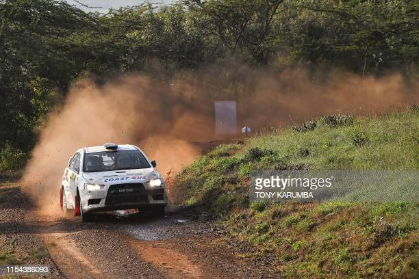 Kenyan rally team Izhar Mirza and Kavit Dave come around a turn in their Mitsubishi Lancer Evo10 on the second course of the last day of the safari...