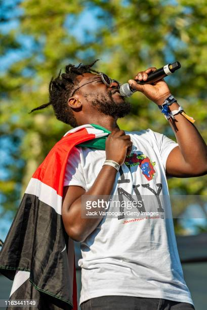 Kenyan Rapper Blinky Bill and his band perform onstage at Central Park SummerStage New York New York July 7 2019 He holds a Kenyan flag over his...
