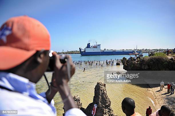 A Kenyan resident takes a picture of the Belize flagged MV Faina as it is escorted to berth at the port of Mombasa on February 12 2009 for fresh...