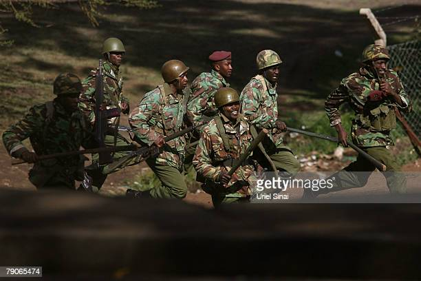 Kenyan riot police charge towards supporters of Kenya's opposition leader Raila Odinga during the second day of attempts to disperse renewed protests...