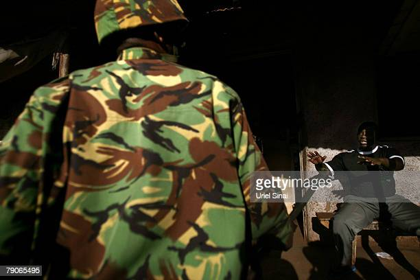 Kenyan riot police search the Kibera slums for supporters of Kenya's opposition leader Raila Odinga during the second day of attempts to disperse...