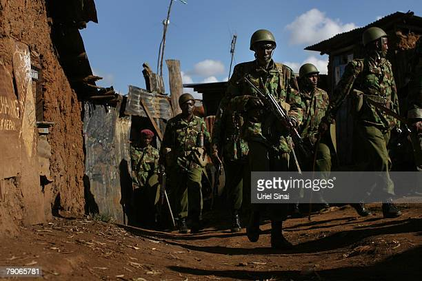 Kenyan riot police search the the Kibera slums for supporters of Kenya's opposition leader Raila Odinga during the second day of attempts by police...