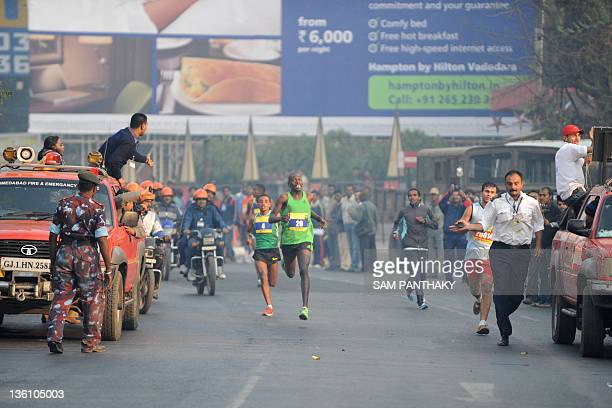 Kenyan runner Philemon Rotich participates in the Sabarmati Marathon 2011 in Ahmedabad on December 25 2011 Rotich finished first in the male category...