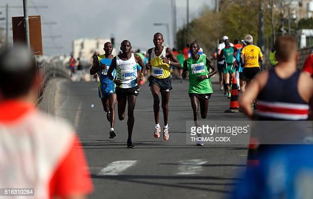 Kenyan runners Shamrock Kipkogey Ronald Kurgat and Mourice Musyoki run in Jerusalem during the 6th Jerusalem's marathon on March 18 2016 Kipkogey won...