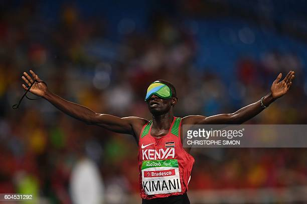TOPSHOT Kenyan Samwel Mushai jubilates after winning the men's 1500M race at the Olympic Stadium during the Rio 2016 Paralympic Games in Rio de...