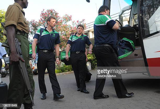 A Kenyan security agent watches as members of the Ireland cricket team board their bus back to their hotel after a match against Kenya on February 18...