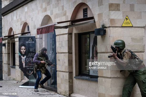 Kenyan security forces enter the building attached to the DusitD2 hotel in Nairobi Kenya on January 15 after a blast followed by a gun battle rocked...
