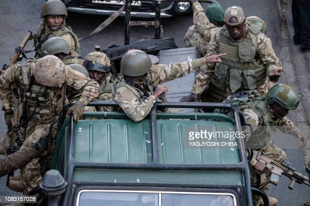 Kenyan security forces get out of a car after a blast followed by a gun battle rocked a upmarket hotel complex in Nairobi on January 15 2019 At least...