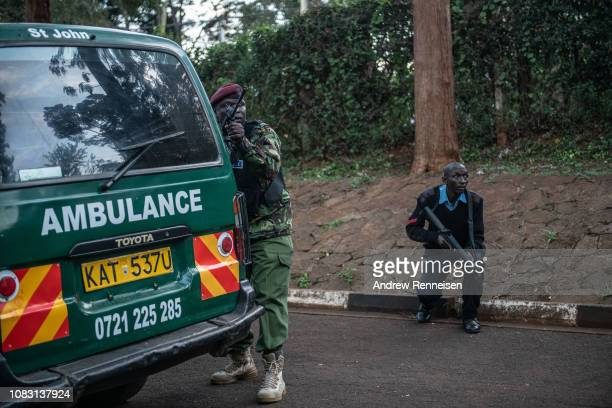 Kenyan security forces take cover after hearing gunfire coming from the Dusit Hotel complex on January 15 2018 in Nairobi Kenya A current security...