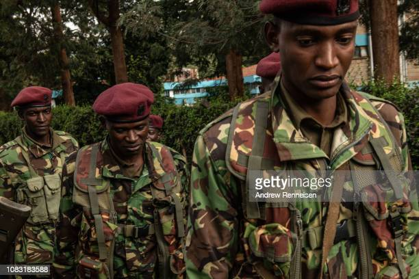 Kenyan security forces walk outside the Dusit Hotel on January 16 2018 in Nairobi Kenya A security operation has continued into a second day after...