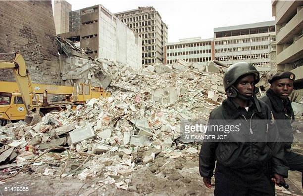 Kenyan security guards keep watch 08 August over the scene of yesterdays bomb explosion near the US embassy in Nairobi The latest toll from the...