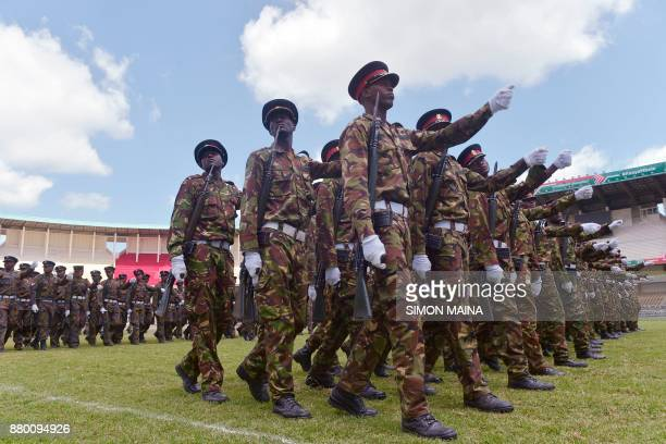 Kenyan soldiers march during a rehearsal a day before the official swearing of Kenya's Presidentelect Uhuru Kenyatta on November 27 2017 in Nairobi /...