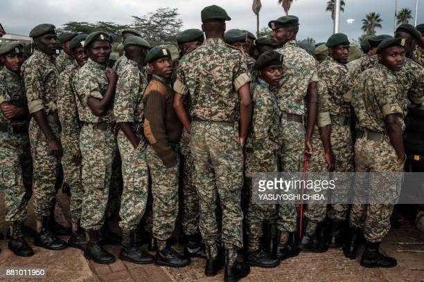 TOPSHOT Kenyan soldiers wait in a line to recieve breakfast packages before Kenya's President inauguration ceremony at Kasarani Stadium in Nairobi on...