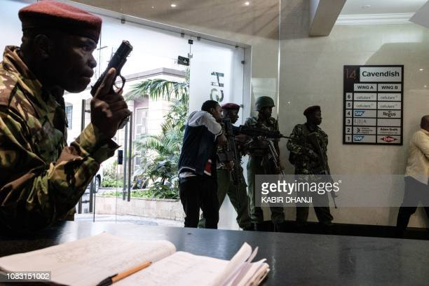 Kenyan special forces intervene after a bomb blast from the office block attached to DusitD2 hotel in Nairobi Kenya on January 15 2019 A huge blast...