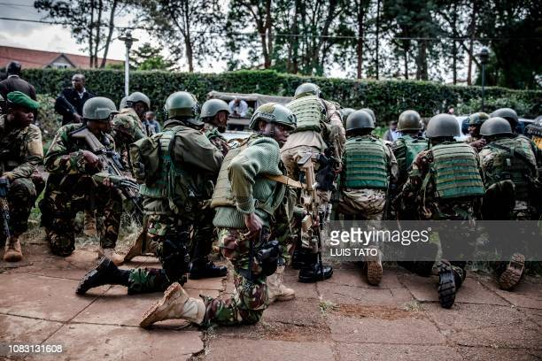 Kenyan special forces take position outside a hotel complex following an explosion in Nairobi's Westlands suburb on January 15 in Kenya. - The...
