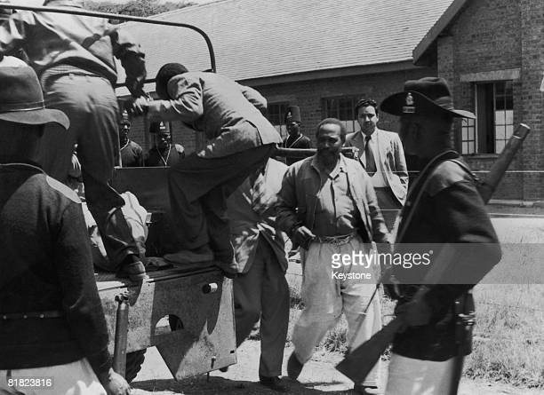 Kenyan statesman Jomo Kenyatta leaves the courthouse at Kapenguria and returns to prison during his trial for involvement in the Mau Mau Rebellion in...