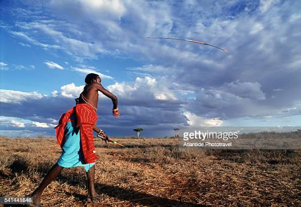 Kenyan tribesman throwing a spear, Ol Malo, Kenya