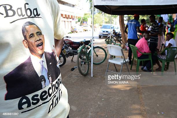MCCONNELL*** Kenyan vendor Hosea displays his tshirts with a depiction of US President Barack Obama at the Kogelo market on July 13 2015 in Kisumu...