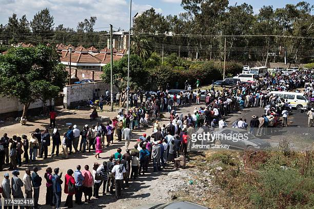 Kenyan voters queued outside a polling station in Nairobi, to vote in the general election, March 4, 2013. Tens of thousands of people waited...