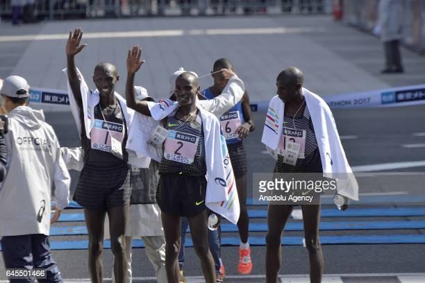 Kenyan Wilson Kipsang Kenyan Gideon Kipketter and Kenyan Dickson Chumba celebrate after the Tokyo Marathon 2017 in Tokyo Japan on February 26 2017