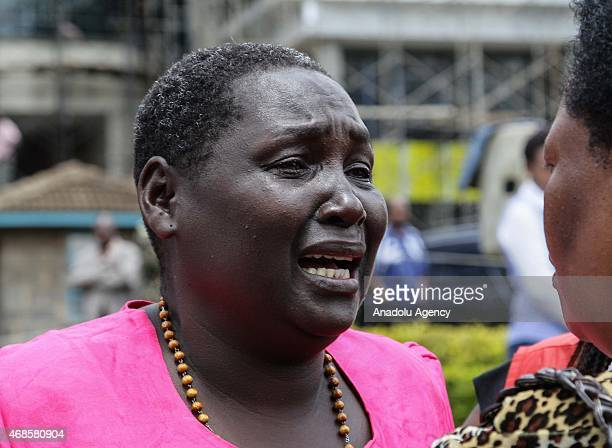 Kenyan woman reacts in front of morgue of Chiromo Campus of Nairobi University on April 04, 2015 after she identified the corps of his relatives...